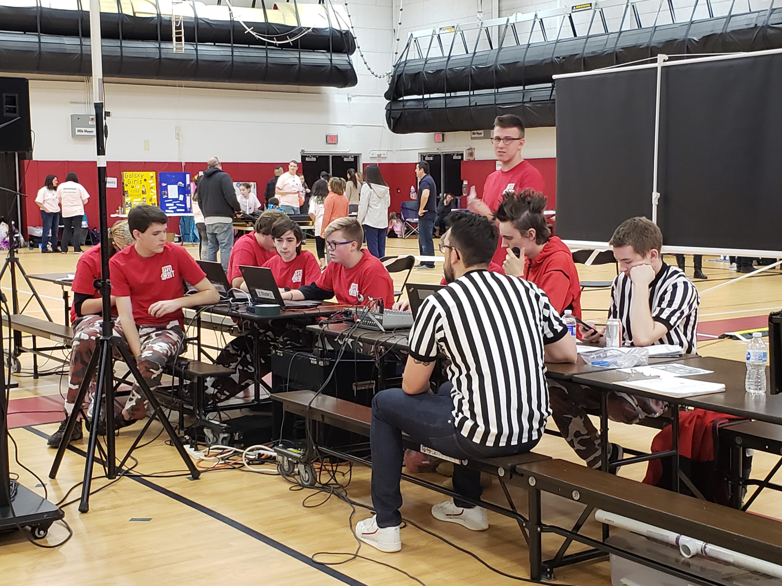 Photo of team members working at a media table at FLL Qualifier