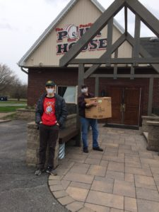 Student picking up food in front of The Pour House to take to healthcare workers