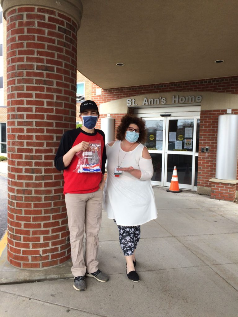 Team member dropping off surgical mask straps at St. Anne's Home