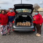 3 people standing by trunk full of boxes of coffee for Rochester General Hospital