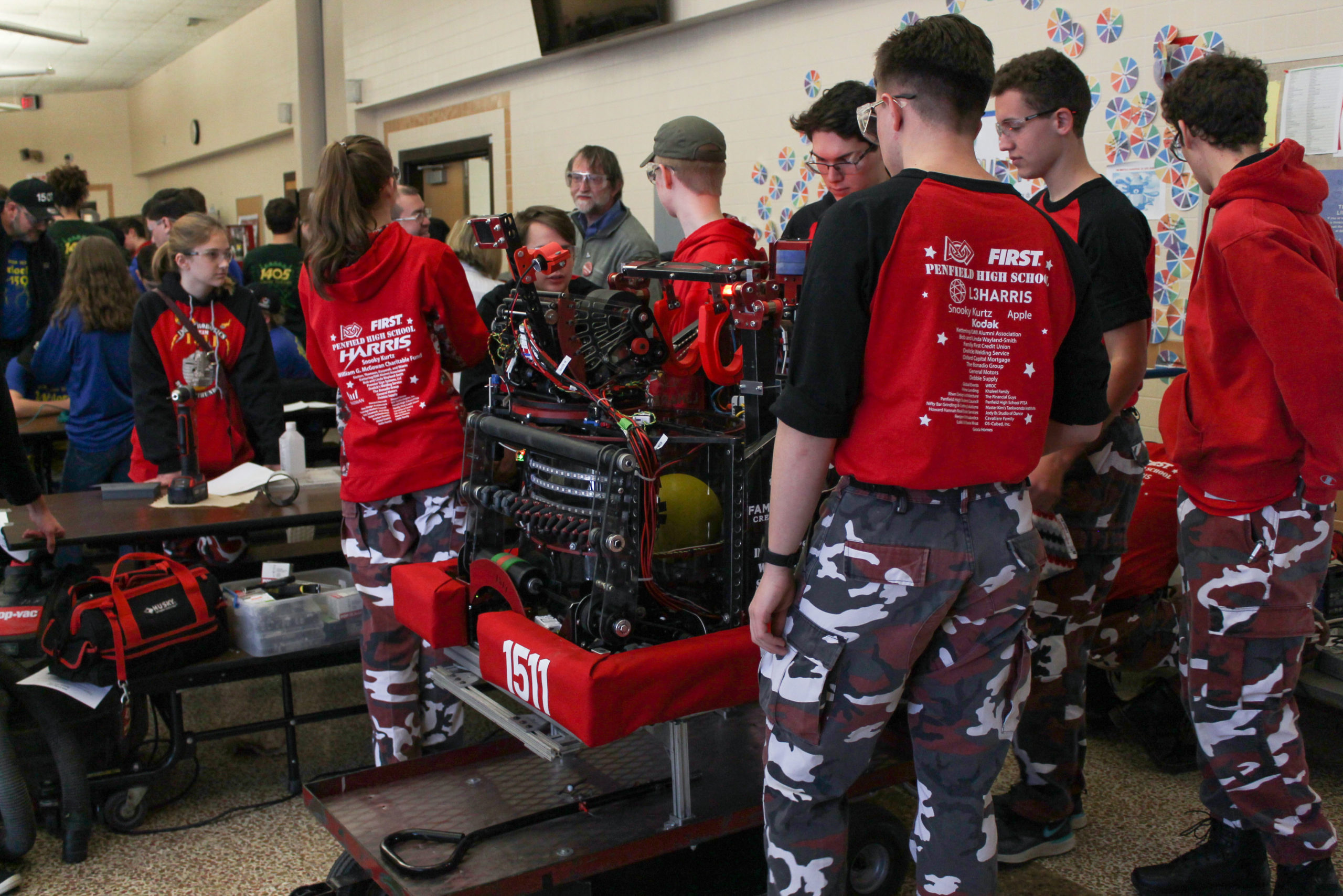 Photo of team members in working on their robot at Rochester Rally