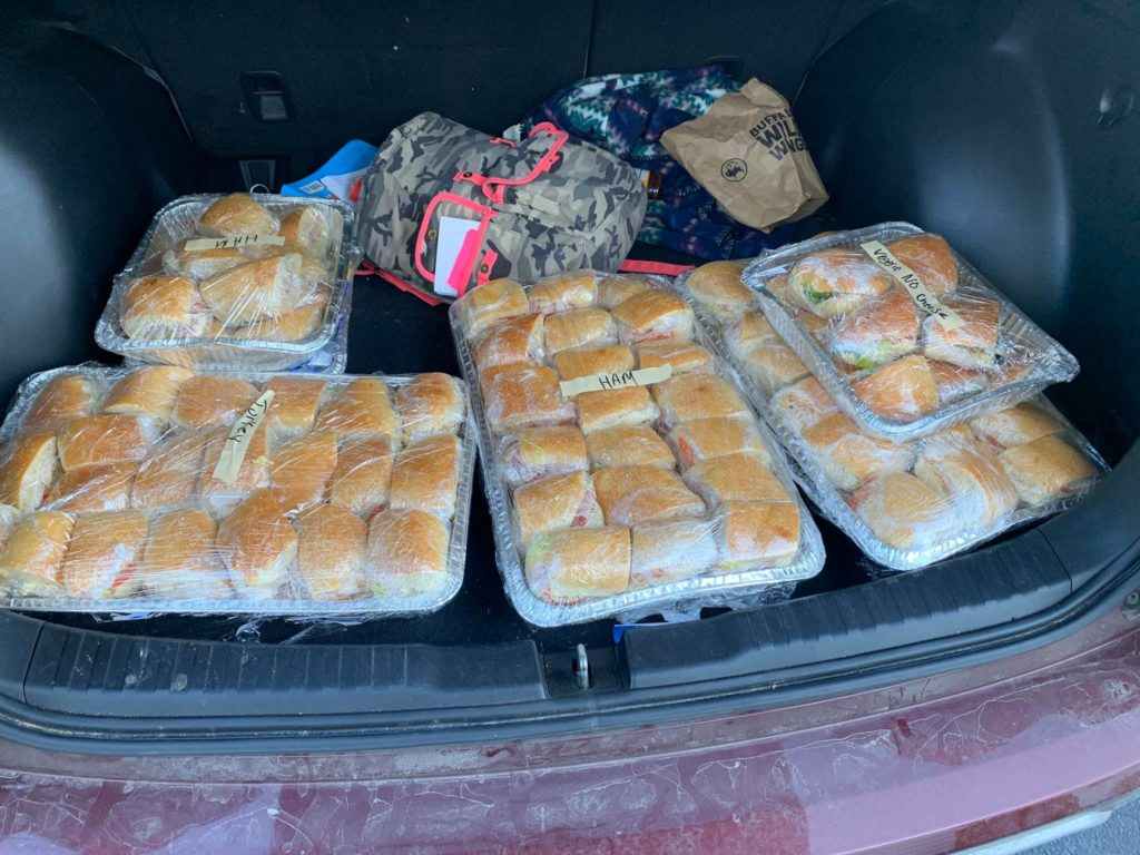Car trunk full of sandwiches for hospital workers