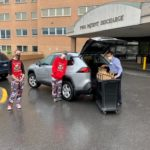 Students delivering snacks and coffee to Rochester General Hospital