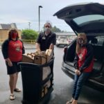 Student delivering snacks and coffee to Rochester General Hospital